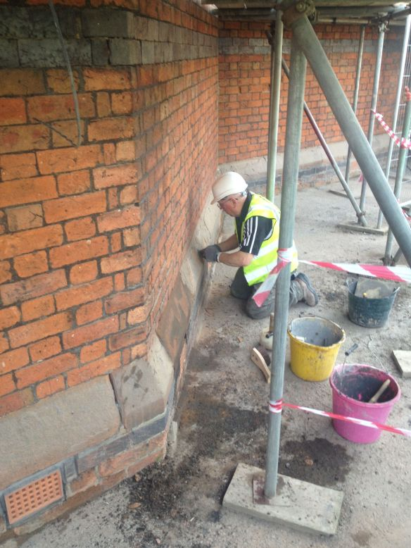 Tom's work protects the stone from future damage from rain water