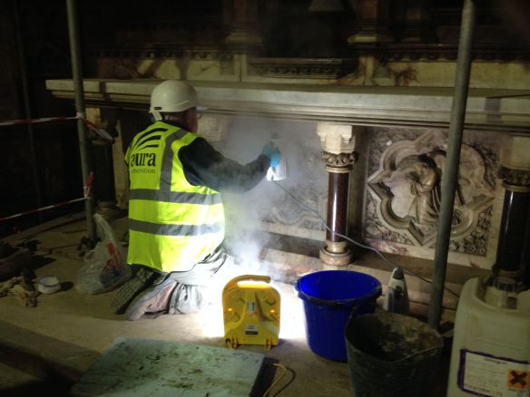 Tom steam cleans the marble on the altar