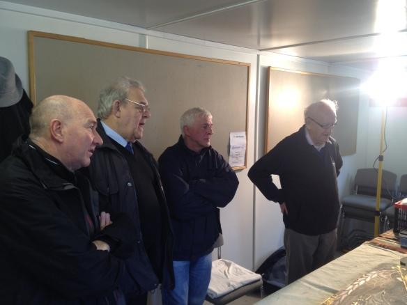 Roger, Tommy, Billy and John listen intently to Silvano.