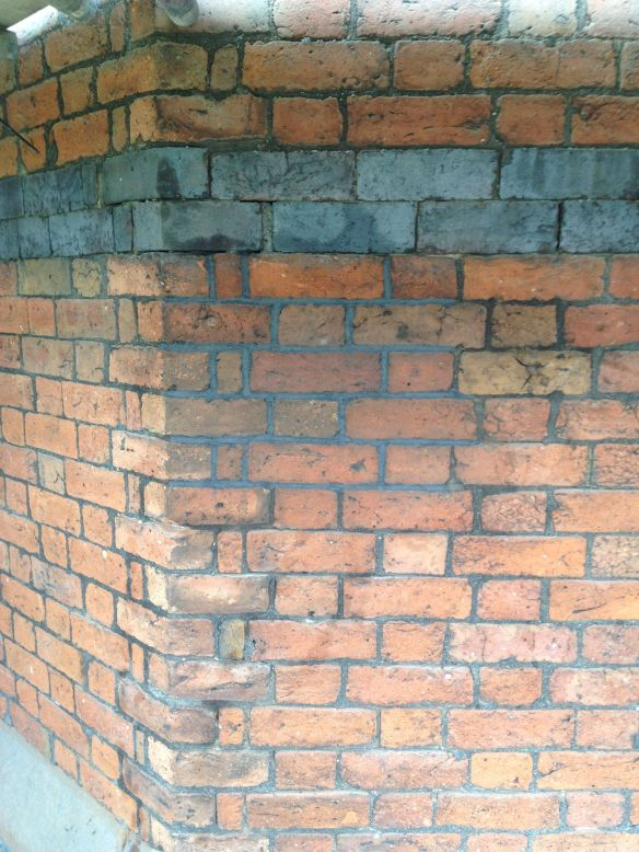 A freshly repointed wall and a job well done.
