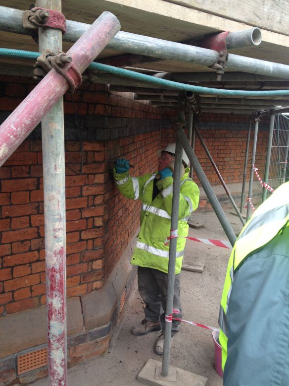Tom in repointing action seen here raking out.