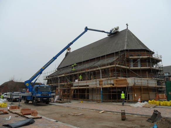 We used a super crane to provide access to both sides of the roof when installing lightning protection.